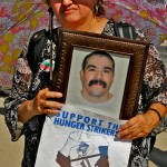 Arazeli holds a photograph of her brother, Sergio Alvarez, who has been imprisoned in Pelican Bay for 16 years.